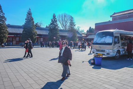 BeijingChina - 25 February 2017:Forbidden Palace with Unacquainted chinese people or touristin and Food truck at beijing Capital City of china,Forbidden Palace was the former king palace in china