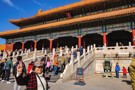 BeijingChina - 25 February 2017: Unacquainted chinese people or touristin come to visit Forbidden Palace in Holiday at beijing Capital City of china,Forbidden Palace was the former king palace in china Редакционное