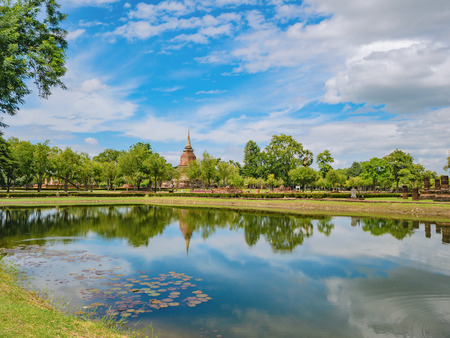 Ruin of Pagoda in Wat mahathat Temple Area and reflection in the water At sukhothai historical park,Sukhothai city Thailand