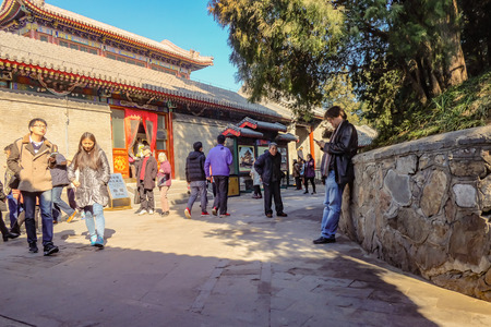 beijing, China - 26 February 2017: Unacquainted Chinese people or tourist walking in Summer palace park in Beijing the capital of China