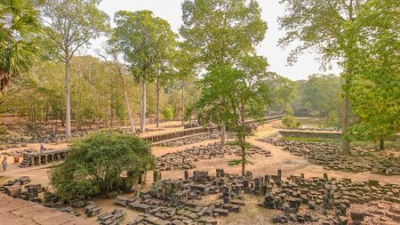 Ancient stone and Park in front of Ancient Stone castle  in Angkor wat Angkor Thom.Siem reap Cambodia