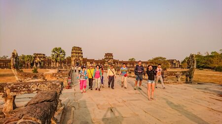 SiemreapCambodia - February 21 2016:Angkor wat siem reap with sunrise in the morning and tourist visit angkor wat,siem reap cambodia,wonder of the world