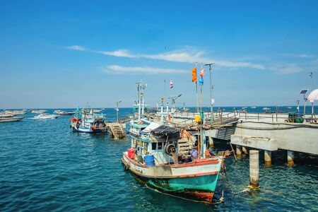 Beautiful view From Koh Lan island Pier with Fisherman Boat park near the pier.Thailand holiday concept