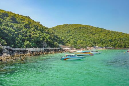 Tropical Idyllic Ocean and Boat on Koh lan Island in vacation time. Koh lan island is the Famous island near Pattaya city the Travel Destination in Thailand,Thailand holiday concept