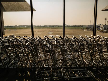 Luggage Cart beside the window in don muang internation airport bangkok City Thailand 写真素材