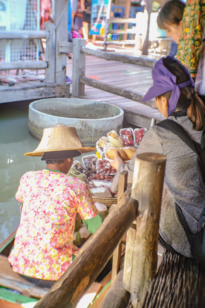 Bangkok, Thailand - 21 June 2017 : Unacquainted Thai People Selling Fresh Fruit on the boat in Pattaya Floating Market. Chonburi Thailand Travel. Pattaya Floating Market is the Famous Floating Market near Pattaya Editorial