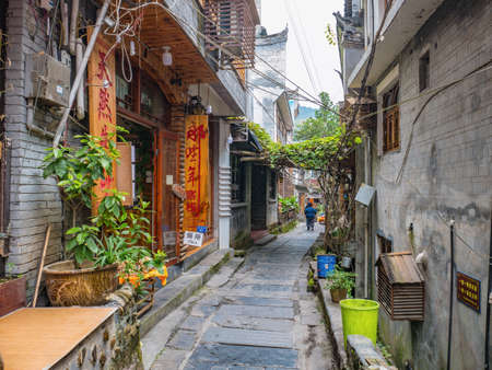 fenghuang,Hunan/China-16 October 2018:Tourist walking in alley building district of Fenghuang ancient town.phoenix ancient town or Fenghuang County is a county of Hunan Province, China Editorial