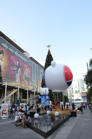 Bangkok,Thailand-December 3: People out of town to watch the Christmas festival on December 03,2011 in Central World Plaza,bankok,Thailand. The decorations on the tree with Christmas lights and a large statue of a bear, and people come to relax and take i Stock Photo - 11400969