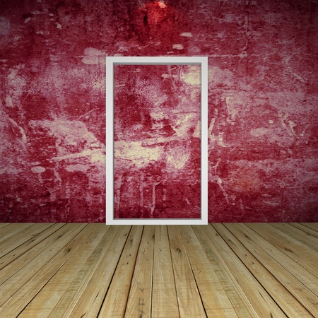 Empty Room with Door on Grunge red wall and wood floor photo