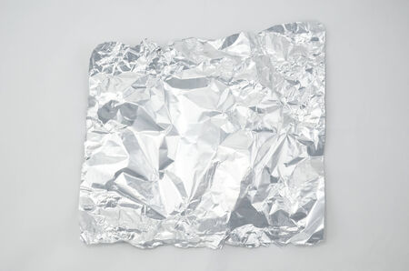 Crumpled Foil isolated on white background photo