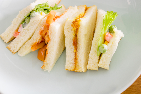 turkey bacon: delicious sandwich with ham vegeable bread on  white dish , home made sandwich, health food,close up