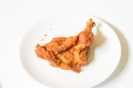 delicious  crispy  fried chicken in  the white dish on a wooden table , close up delicious fried chicken , close up