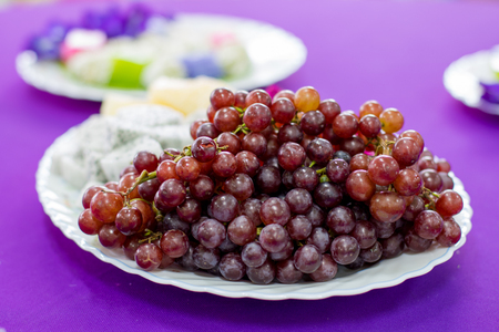 delicious  fruit , grapes, dragon fruit , melon  on the white bowl , healthy food for everybody with copy space Stock Photo