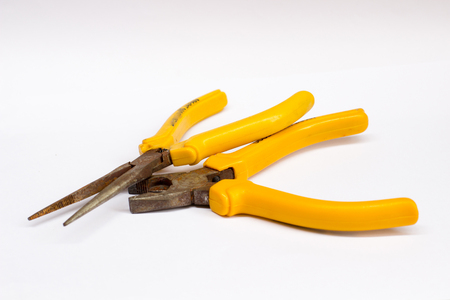 the pliers on the wooden floor with copy space on white background isolate