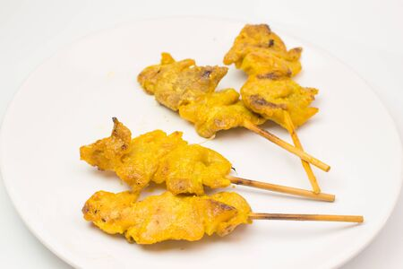 grilled pork satay with peanut sauce and vinegar on the white dish and white background isolate Stock fotó