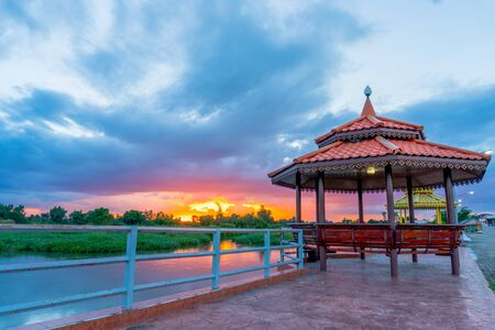 the beautiful pavilion near the river with the beautiful sunset on the evening