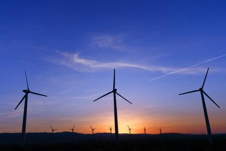 Windmill at sunrise Stock Photo