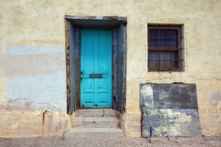 Turquoise door on rustic house in historic district in Tucson, AZ   Stock Photo - 19814498