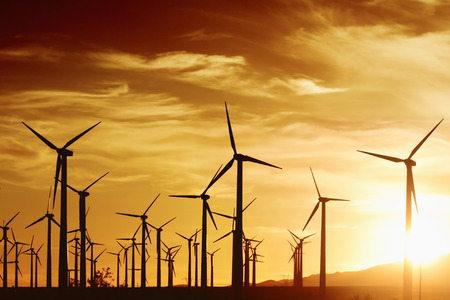 Wind turbines in golden sunset, Palm Springs, CA  Stock Photo