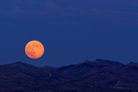 barstow: Supermoon rising over desert mountains on August 10, 2014 in Barstow, California