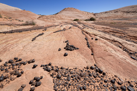 iron oxide: Moqui Marbles Iron Oxide Concretions from Navajo Sandstone Grand StaircaseEscalante National Monument UT. Stock Photo