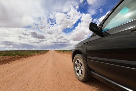 ut: Off road car driving on desert dirt road Canyonlands National Park UT