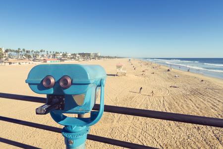 huntington beach: Binoculars at Huntington Beach pier, California with vintage effect
