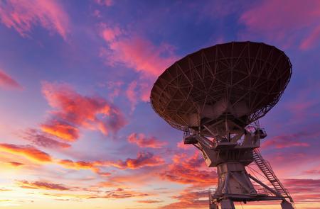 radio telescope: Radio Telescope at Very Large Array in Sunset near Soccoro, New Mexico