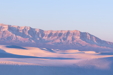 chihuahua desert: White sand dunes takes on pink color at sunrise, White Sands National Monument, New Mexico Stock Photo