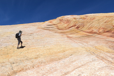 cottonwood canyon: Female Hiker on Yellow Rock - multicolored sandstone rock in Grand Staircase-Escalante National Monument, Utah