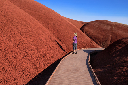 Female Hiker on the Painted Hills Cove Trail, John Day Fossil Beds National Monument, Oregon Stock Photo