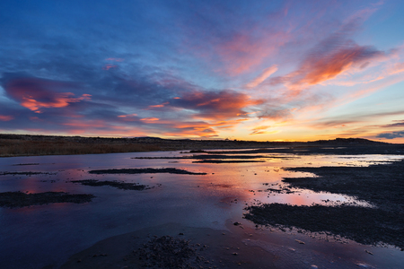 Beautiful sunset sky reflecting on water, Antelope Island State Park, Utah