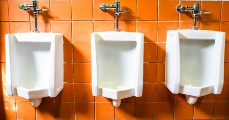 piddle: mens public toilet Stock Photo