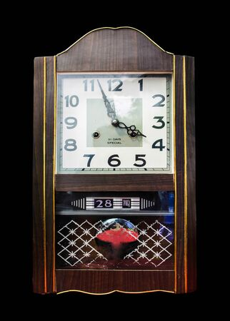 wooden clock: Antique wooden clock isolate on black background