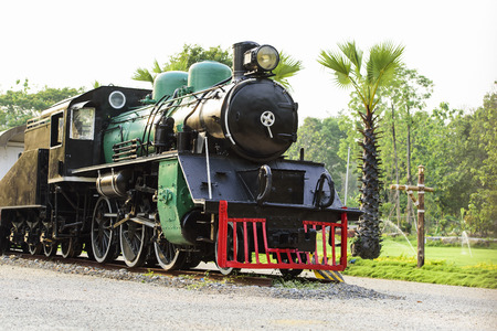 Ancient steam locomotive stopped in resort Chaingmai Thailand