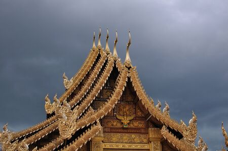 squall: Thai style ancient roof in days was going to rain at Lamphun province thailand Stock Photo