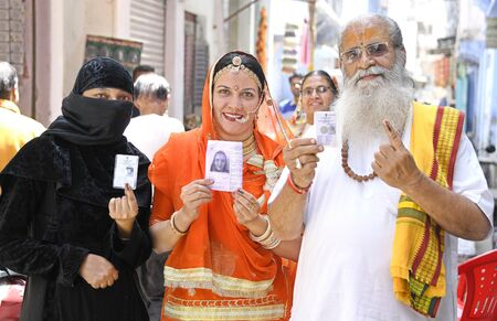 Voters of Hindu & Muslim community together show inked finger after casting vote at a polling station in Beawar, Rajasthan, India. PhotoSumit Saraswat