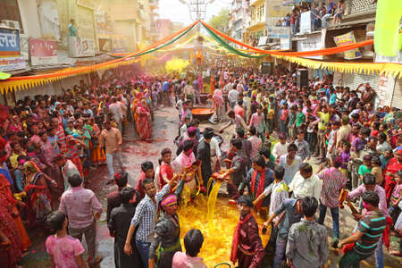 Beawar, Rajasthan, March 25, 2016: Bhabhi (sister-in-law) and Devar (brother-in-law) playing Kodamar Holi festival in Beawar. Women dip ropes in colored water before using them to playfully beat men.