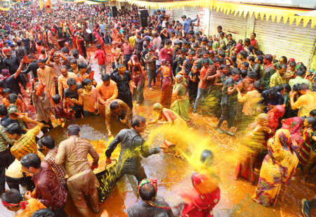 Beawar, Rajasthan, March 25, 2016: Devar (brother-in-law) thrown colorful water on Bhabhi (sister-in-law) and women beat men with ropes as per traditional culture Kodamar Holi festival in Beawar. Sajtókép