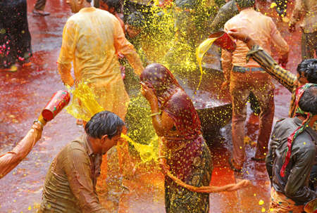 Beawar, Rajasthan, March 25, 2016: Devar (brother-in-law) thrown colorful water on Bhabhi (sister-in-law) and women beat men with ropes as per traditional culture Kodamar Holi festival in Beawar.