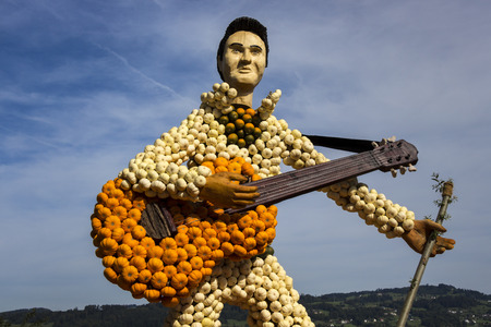Guitar and guitarist made of small, colourful pumpkins