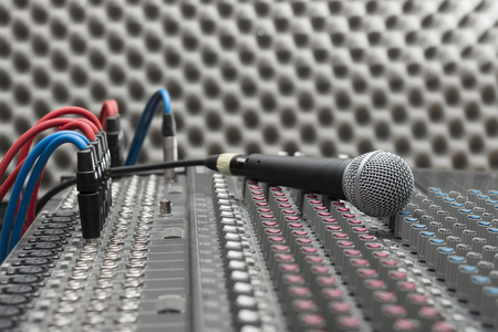 Microphone close-up on the studio mixer photo