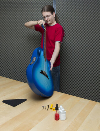 e guitar: Guitar technician checking the electro-acoustic guitar    Series with the same model available