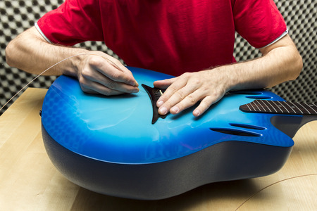 e guitar: Guitar string is being changed    Series with the same model available