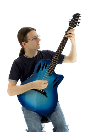 Guitarist with a blue guitar on a white background photo