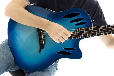 e guitar: Guitarist is playing an electroacoustic guitar, close-up  Series with the same molde available  Stock Photo