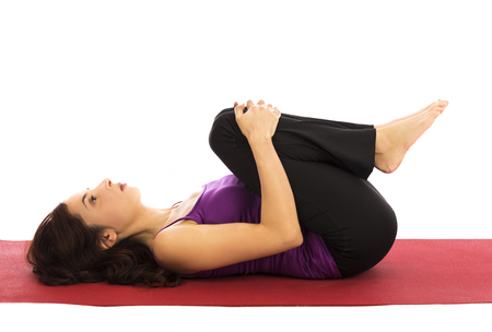 back training: Young woman relaxing during yoga