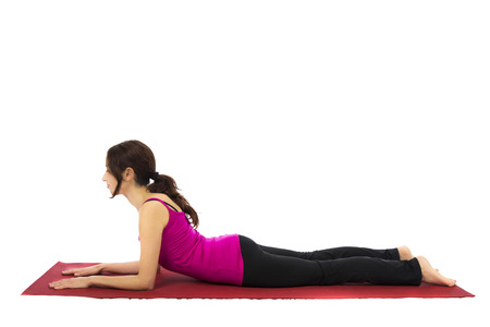 Young woman doing Sphinx Pose in Yoga  Series with the same model available Stock Photo