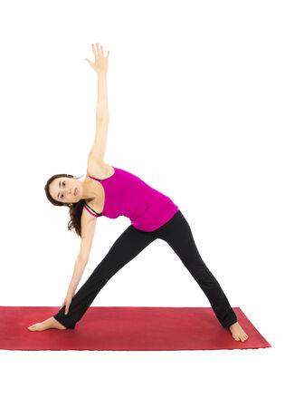 Young Woman doing Extended Triangle Pose in Yoga