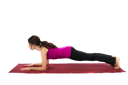 Young woman doing Forearm Plank in Yoga photo